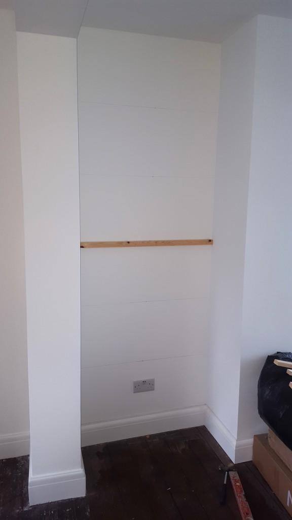 Handyman building shelving